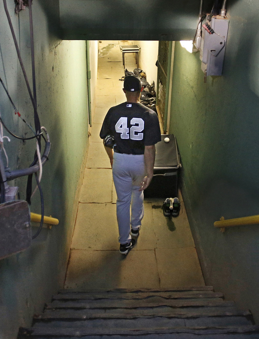 New York Yankees closer Mariano Rivera walks down into the the tunnel before his last game against the Boston Red Sox at Fenway Park