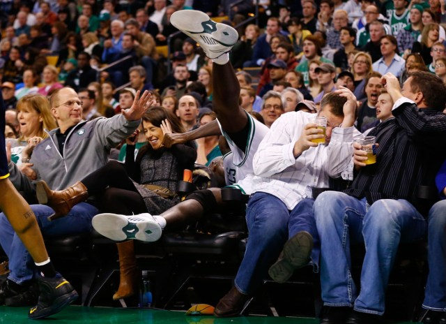 Kevin Garnett #5 of the Boston Celtics spills into the fans sitting in the court side seats before flipping over a chair after attempting to grab a loose ball against the Indiana Pacers during the game on January 4, 2013 at TD Garden in Boston, Massachusetts.