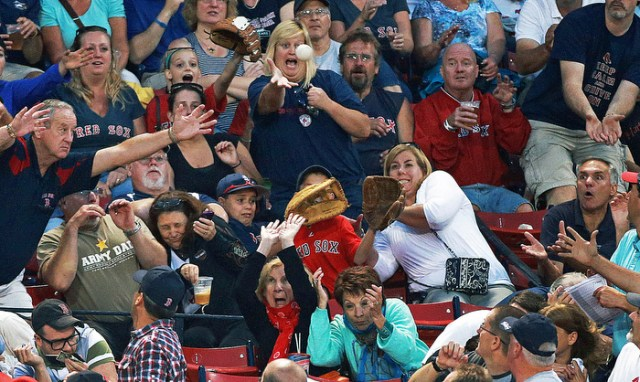 Fans wear many different looks and have just as many different reactions as a first inning foul ball screams towards them. The Boston Red Sox hosted the Baltimore Orioles in an MLB regular season game at Fenway Park.