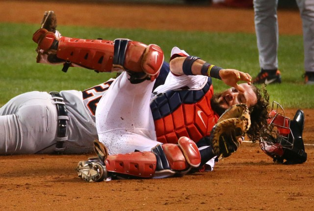 Boston-10/19/13-- ALCS game 6 Red Sox vs Tigers, Sox Jarrod Saltalamacchia rolls over Tigers Prince Fielder after tagging him out in the 6th inning in a rundown between home and 3rd base.