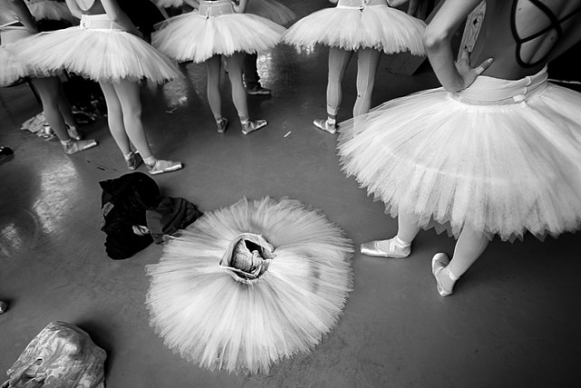 """Boston, MA., 10/16/13, Boston Ballet rehearsal of Act III from """"La Bayadere."""" The piece is called """"The Kingdom of Shades"""" and features 32 female dancers in classical tutus. During the rehearsal it appears that one of the ballerinas left in a hurry."""