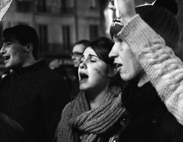 "On the Place de l'Hotel de Ville in Aix-en-Provence, France, a supporter with ""Charlie"" written on her cheek chants during demonstrations honoring the victims of the Charlie Hebdo shooting on January 8."