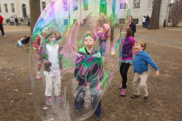 April 3, 2015 - From left, Tess Anderson, 6; Archie Kean, 7; Liadan Flanagan, 9; and Fintan Flanagan, 5, play with bubbles blown by Harvard College students in Harvard Yard.