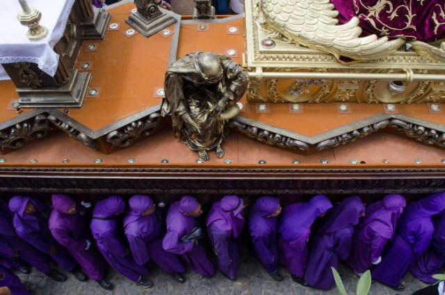 Cucuruchos carry the float that is adorned with Jesus carrying the cross as part of the Santa Ana procession in Antigua Guatemala on the 3rd Sunday of Lent