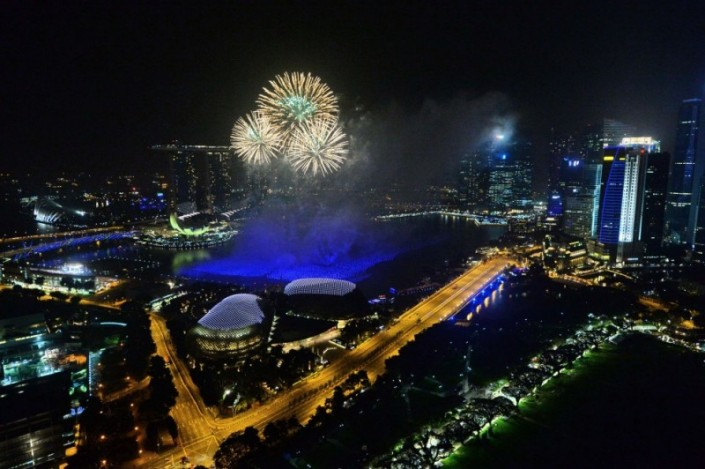 """Celebrating New Year 2014-Fireworks burst over the Singapore skyline during New Year celebrations"""
