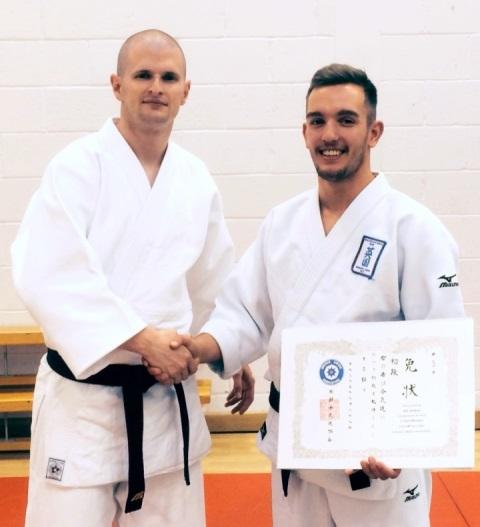 Phil Presents Seb his Dan Grade Certificate