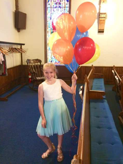 Welcoming the congregation with balloons!