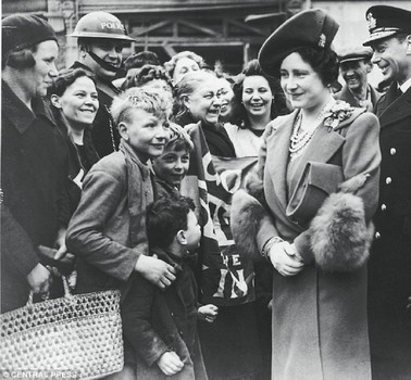 Queen Elizabeth and King George visiting blitz victims after a particularly harsh night of bombing on London's East End - 1940.