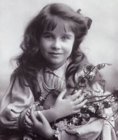 """Living up to her sign's standard by trait and by name, Lady Elizabeth Bowes-Lyon was by all accounts a vivacious child with a warm and """"sun-ny"""" (Leo's planetary ruler) personality."""