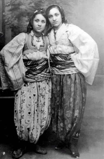 Mother Teresa (left) at the age of 15 and her sister Aga in traditional Kosovo Albanian costume.