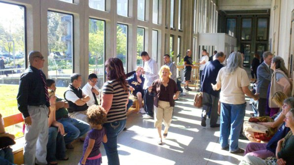 People wait inside the Santa Cruz Courthouse for department 3 to open.