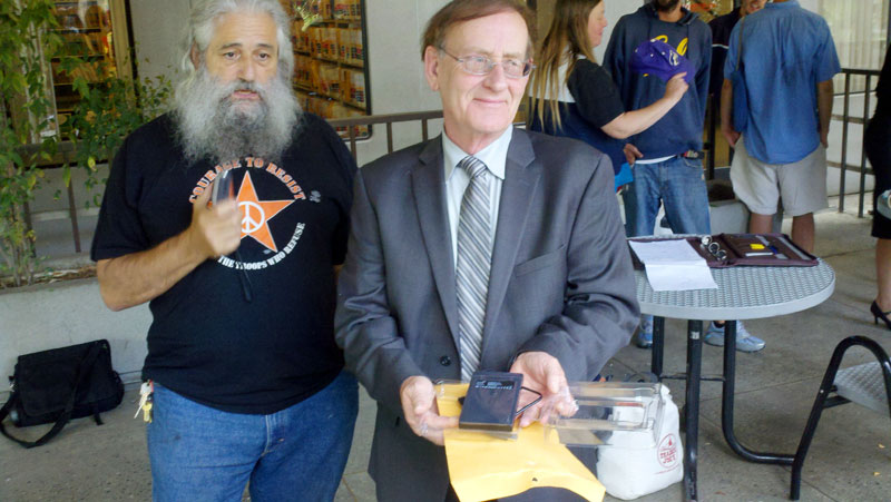 Robert Norse and Attorney David Beauvais with External Hard Drive from the DA