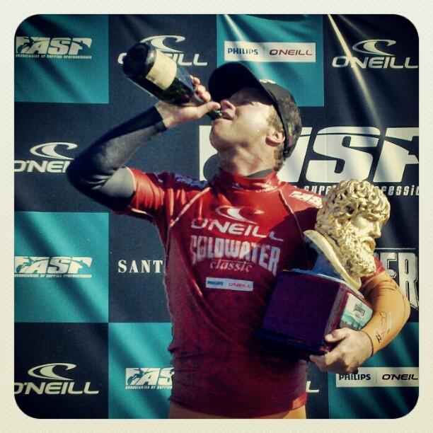 Winner Taj Burrow celebrates with Champagne and trophy