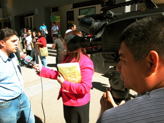 Juan is interviewed by a reporter from Univision, a spanish language news network