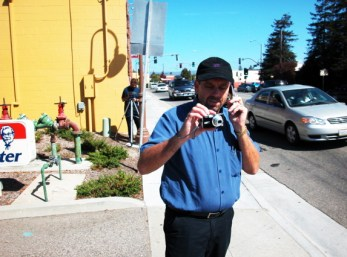 This is the manager of the KFC shown taking photos of demonstrators and calling someone on the phone to report about the demonstration. I have to thank him for trying to get the message out there. Maybe he will send the photos directly to Yum! Brands, Inc., the parent company of KFC. Maybe Yum! Brands will actually stop financing the torture of chickens.