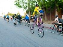 Tall Biker and Longboarder on Santa Cruz Bike Party