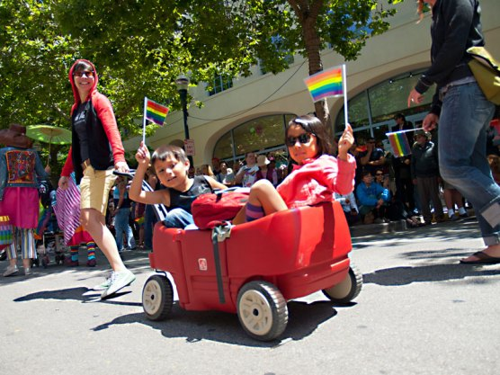 Kids Float Along Pacific Avenue in a Wheelbarrow
