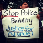 "Natalie Mendoza, Frank Alvarado's niece, held a sign reading ""Stop Police Brutality. Justice for my uncle!"" at the July 12 rally in East Salinas."
