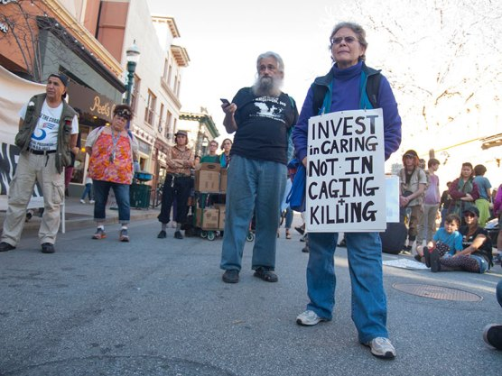 Invest in Caring, Not in Caging and Killing
