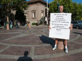 Steve Pleich Holds a Sign in Solidarity with Prisoners and Against Torture in Prisons