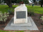"""The Bataan Memorial, a rock with an embedded plaque, is located at the entrance of Bataan Park near the intersection of Market and Monterey Streets. The plaque reads: """"Bataan Park. This park is dedicated by the City of Salinas to the men who served with Company C, 194th Tank Battalion, California National Guard, during World War II and were captured on Bataan on April 9, 1942. May time never tarnish the memory of their sacrifice."""""""
