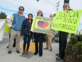 Desiree Banzhaf and Pam of Santa Cruz stand with Lauro Navarro, a former strawberry worker and long-time Watsonville activist, and Gloria Gracida, a resident of Baja California.
