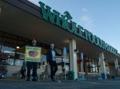 "Michael Joseph urges customers at a Whole Foods Market in Santa Cruz, ""Don't buy Driscoll's berries until all farmworkers get the basic human rights they deserve!"""
