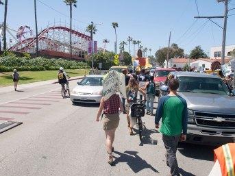 Marching Through Cars on Beach Street in Santa Cruz