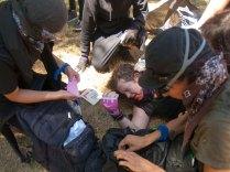 Anti-Fascist Medics Attend to An Injured Comrade