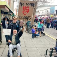 "Man Declares ""Keep the Revolution Going!"" While Holding ""No More Presidents"" Sign"