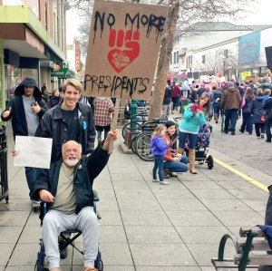 """Man Declares """"Keep the Revolution Going!"""" While Holding """"No More Presidents"""" Sign"""