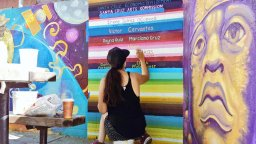 Adding Names of Artists to Huge Mural in Beach Flats Park