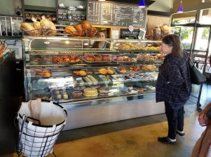 After learning that the cafe is closing, a customer at Heather's Patisserie appears to be having a tough time deciding which pastry to get.