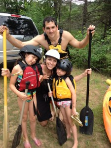 A photo of Bree and Brad and their girls dressed and ready to paddle some rapids.