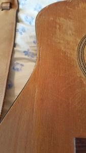 repaired guitar one closeup
