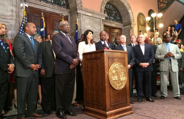 A moment in our history that makes ME proud: Leaders stand with Nikki Haley as she calls for the flag to come down.