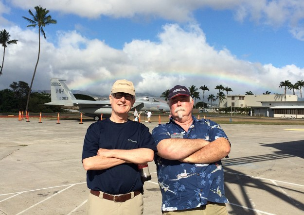 Your truly with our correspondent Burl in Hawaii on a less-panicky Saturday in 2015. Note the rainbow.