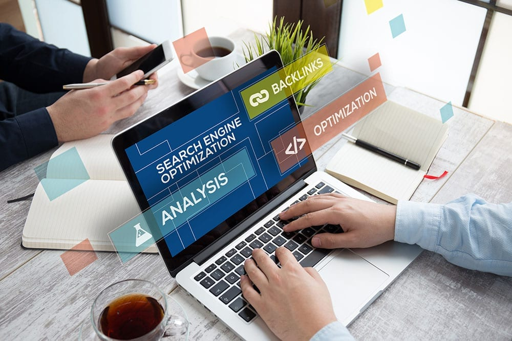 laptop with person working on search engine optimization on a website