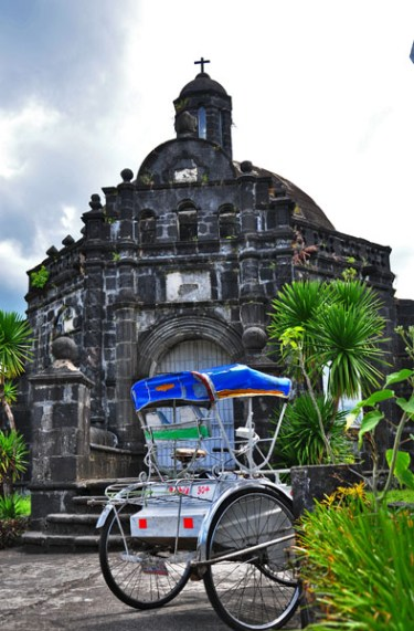Two of Tabaco City's tourist attractions: The Old Camposanto (cemetery) and the ubiquitous 'padyak'.