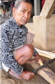If not out in the fields tending rice, the menfolks are busy making native brooms, smithing knives, or carving.