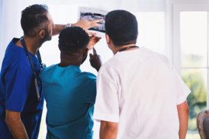 Three Doctors examining an Xray