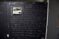 GEORGE RUE / into the cold water / A photograph paired with text copied from the pages of the artist's journal embodies the artist's memory of time spent on Percy Priest Lake in Nashville, Tennessee. The intimate, personal nature of the memory and its records is juxtaposed with the public, pedagogical nature of the blackboard. At the same time, the palpable nostalgia becomes a gateway to the large, open space that is the setting of the memory, and which is so different from the constraints of the small classroom.