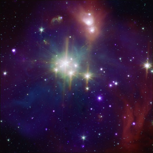 The Coronet Cluster in X-rays from Chandra (purple) and infrared from Spitzer (orange, green, and cyan)