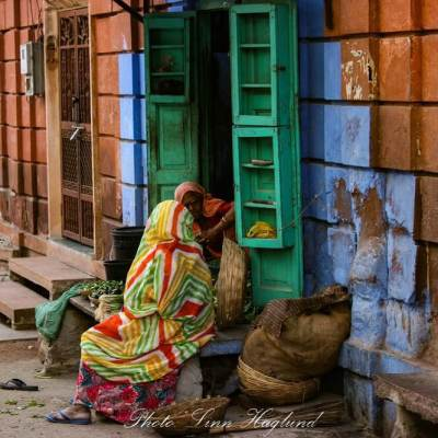 Two indian women chatting outside their door in Jodhpur, India