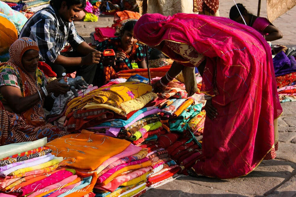 A woman shopping for clothes in Rajasthan, India