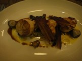 Pan Seared Scallop With Golf Ball Potato, Speck Leek Fondue, Mushroom and Rosemary Chicken Jus