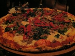 Rapini, Crumbled Sausage, Roasted Red Peppers and Provolone Wood-Fired Pizza