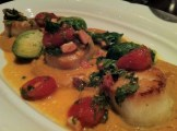 Pan seared scallops, with butternut squash puree, Brussel sprouts, and a tomato, bacon and yuzu tobiko vinaigrette