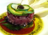 Maguro Tartar - Freshly chopped seared tuna infused with garlic soy and herb wasabi oil, garnished with avocado and tonburi seeds