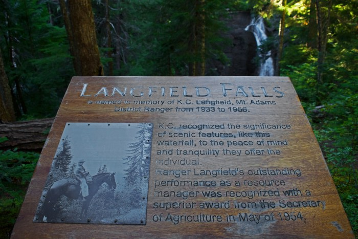 Sign describing K.C. Langfield, the forest ranger from 1933 to 1956 for whom these falls were named